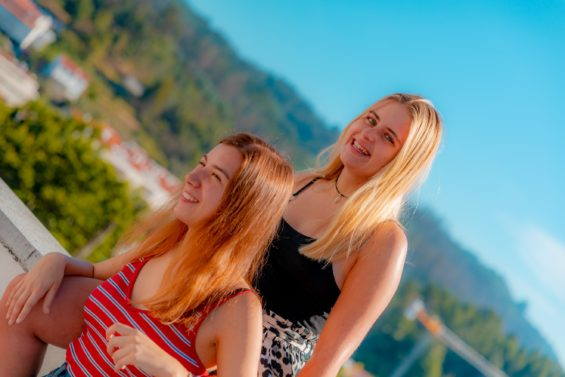 two girl friends smiling at SPEAK Village 2019- SPEAK helps you integrate into a new country