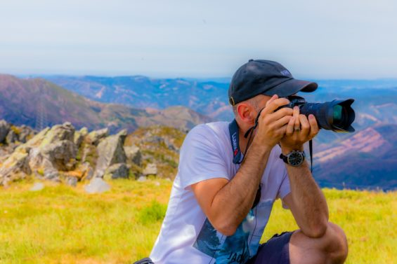 man capturing a photo- capture every opportunity that you have to not forget a language