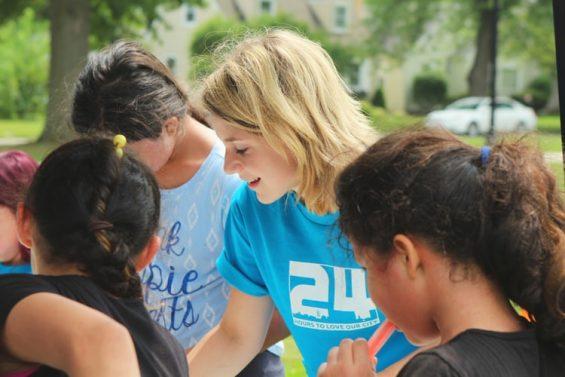 A volunteer wearing a blue top