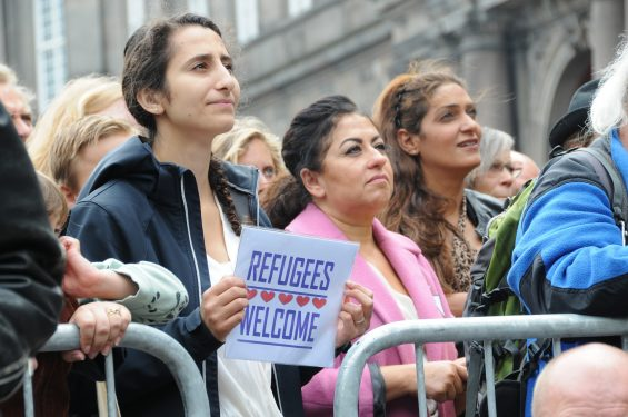 citizens demonstrating for refugees in the country